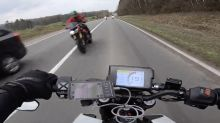 Near miss as motorcycles approach head-on during overtake