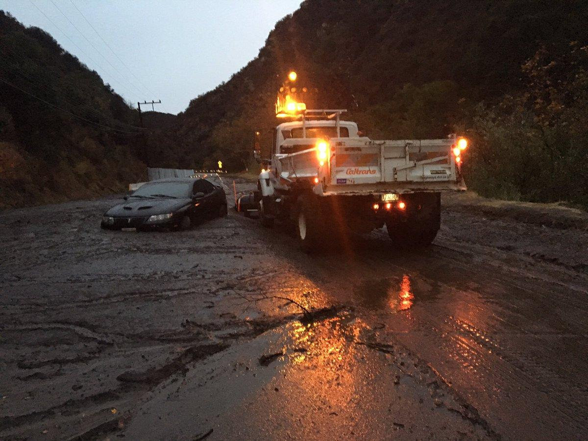<p>Emergency crews assist in rescue during heavy rain and mudflows in Southern California on Jan. 9, 2018. (Photo: LAPD HQ) </p>