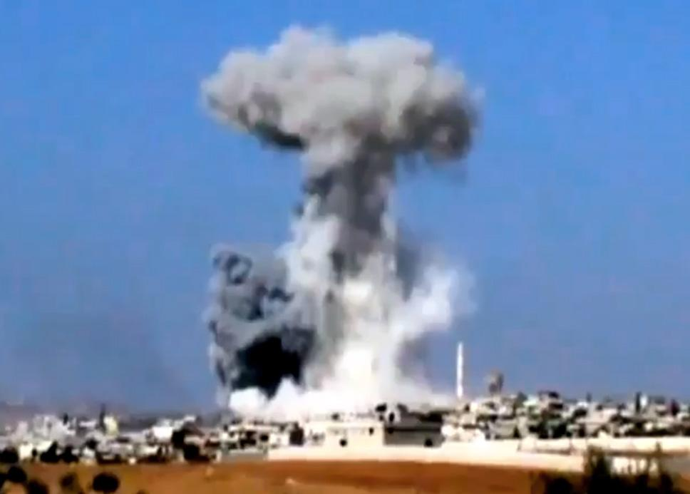 This image taken from video obtained from the Shaam News Network, which has been authenticated based on its contents and other AP reporting on Tuesday, Oct. 16, 2012, purports to show smoke rising due to heavy bombings from military warplanes, not pictured, in Idlib province, northern Syria, on Monday, Oct. 15, 2012. Syrian government warplanes unleashed deadly airstrikes on rebel strongholds in the country's north on Tuesday, activists reported. (AP Photo/Shaam News Network via AP video)