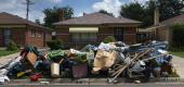A house on a suburban street with belongings left on the lawn in Detroit. (AP)