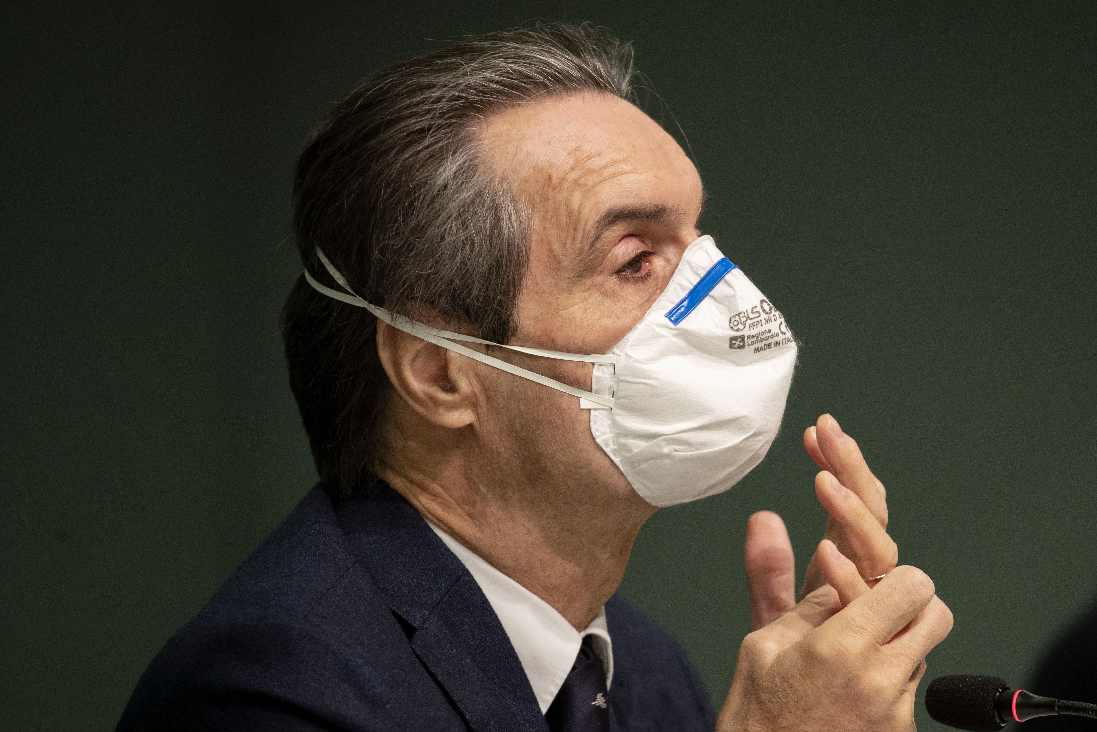 FILE -- In this March 31, 2020 file photo Lombardy region president Attilio Fontana attends a news conference to present the new Ospedale Fieramilano hospital to treat coronavirus patients, in Milan, Italy. The governor of Lombardy, Italy's hardest-hit region in the pandemic, acknowledged on Saturday that he is being investigated by Milan prosecutors over a lucrative contract to obtain protective medical gowns from his brother-in-law's company. (AP Photo/Luca Bruno)