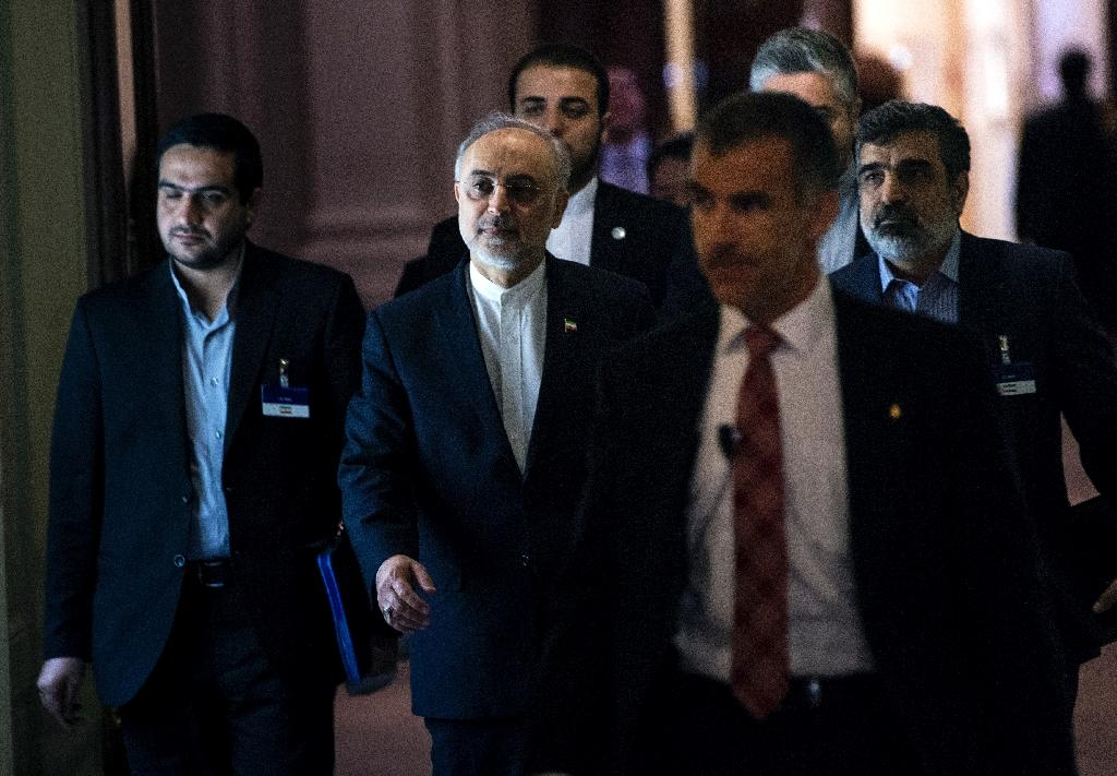The head of Iranian Atomic Energy Organization, Ali Akbar Salehi (C), walks after a meeting at the Beau Rivage Palace Hotel during an extended round of nuclear talks on April 1, 2015 in Lausanne (AFP Photo/Brendan Smialowski)