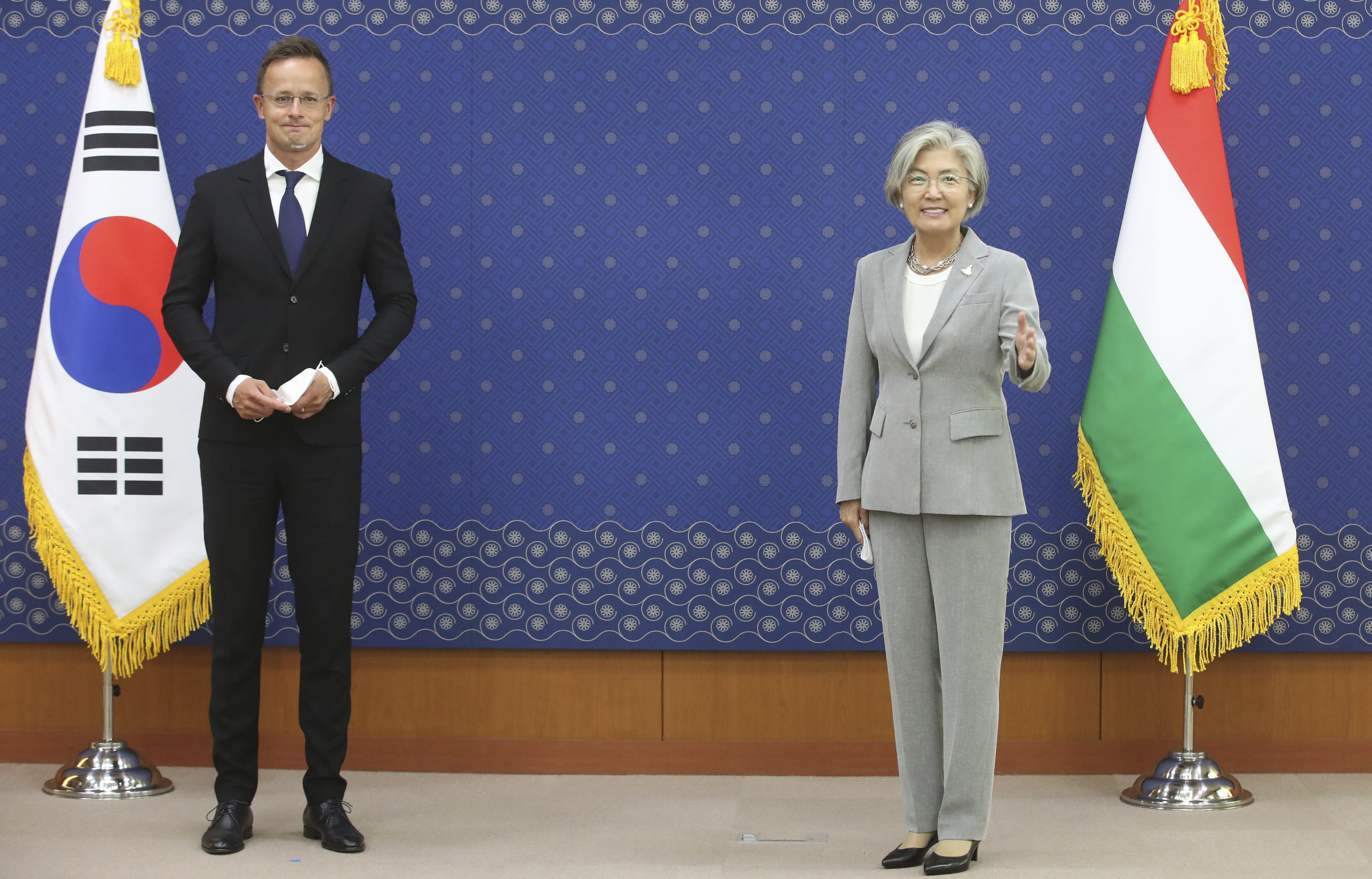 South Korean Foreign Minister Kang Kyung-wha, right, and Hungarian Foreign Minister Peter Szijjarto, left, pose for the media before their meeting at Foreign Ministry in Seoul, South Korea, Monday, July 27, 2020. (Kim Myung-won/Newsis via AP)