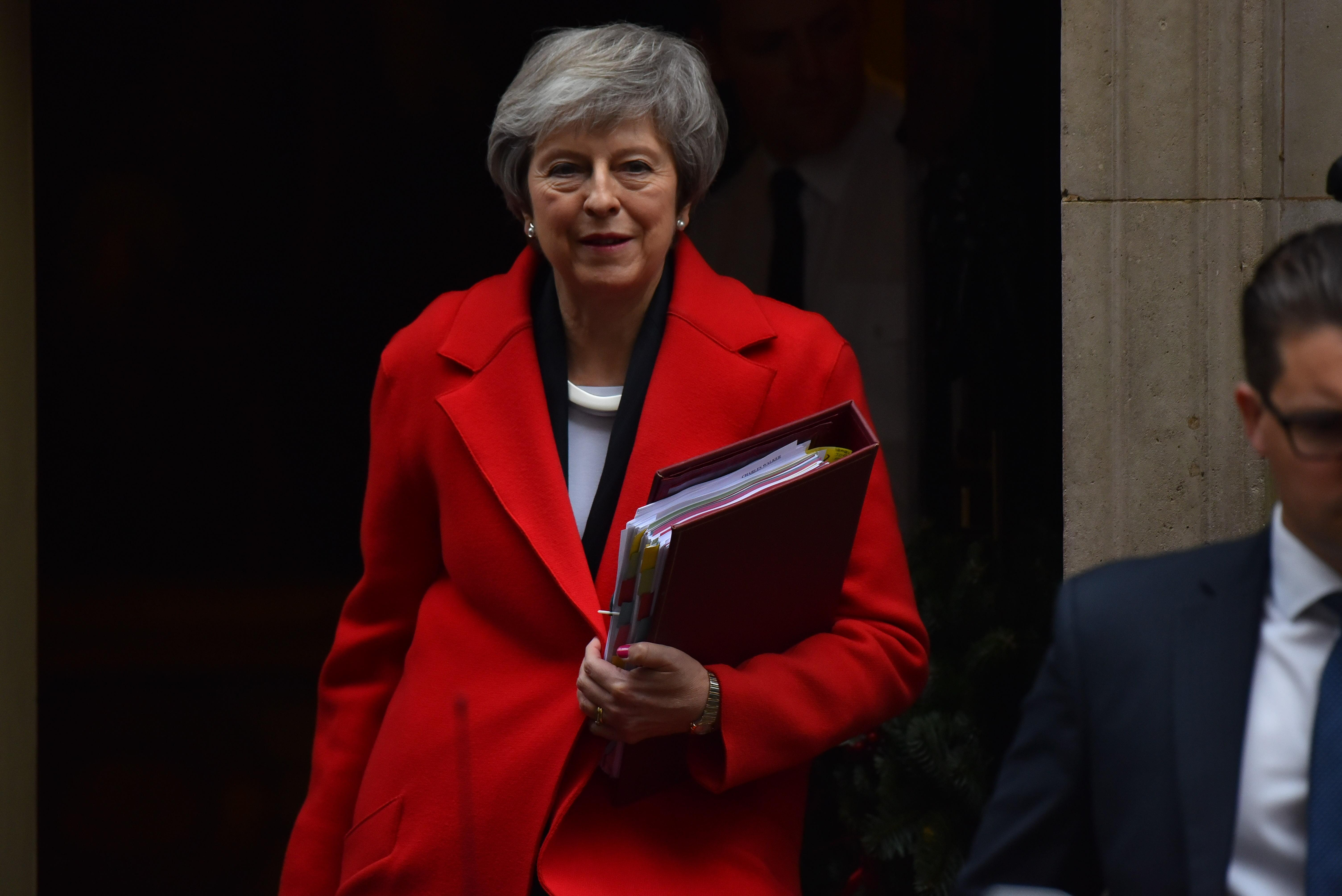 theresa may delays decision on brexit