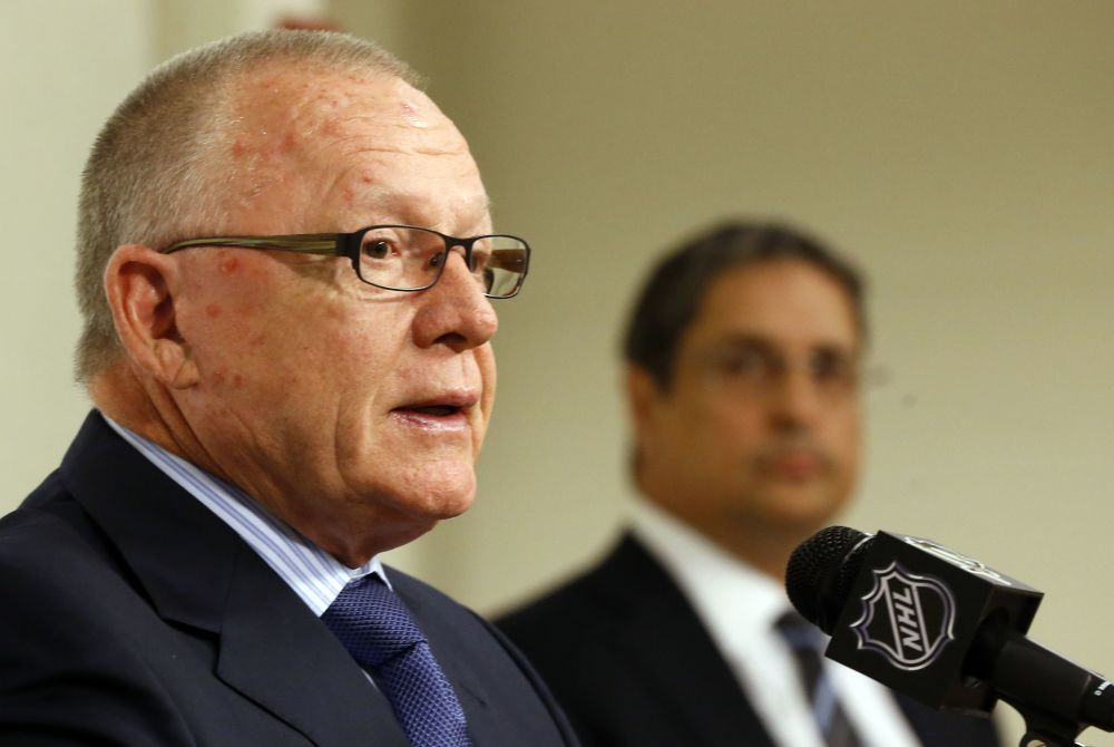 Jim Rutherford, left, takes questions as Penguins President David Morehouse listens after Rutherford was introduced as the new general manager for the Pittsburgh Penguins NHL hockey team  at a news conference on Friday, June 6, 2014, in Pittsburgh