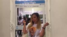 Tiny Shows Off Daughter's Mug Shot on a T-Shirt