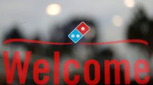 Overseas costs drag on profits at Domino's Pizza; shares slide