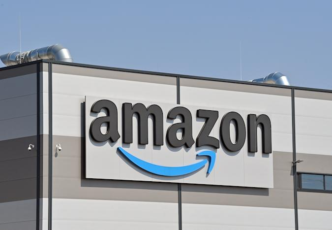 28 April 2021, Brandenburg, Kiekebusch: The logo of Amazon, (Amazon.com, Inc., listed US online mail order company), at the shipping warehouse in Kiekebusch, a district of the municipality of Schönefeld in the district of Dahme-Spreewald. Photo: Patrick Pleul/dpa-Zentralbild/ZB (Photo by Patrick Pleul/picture alliance via Getty Images)