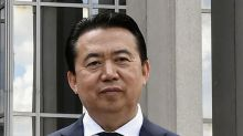 Chinese court jails former Interpol chief for 13-1/2 years over graft