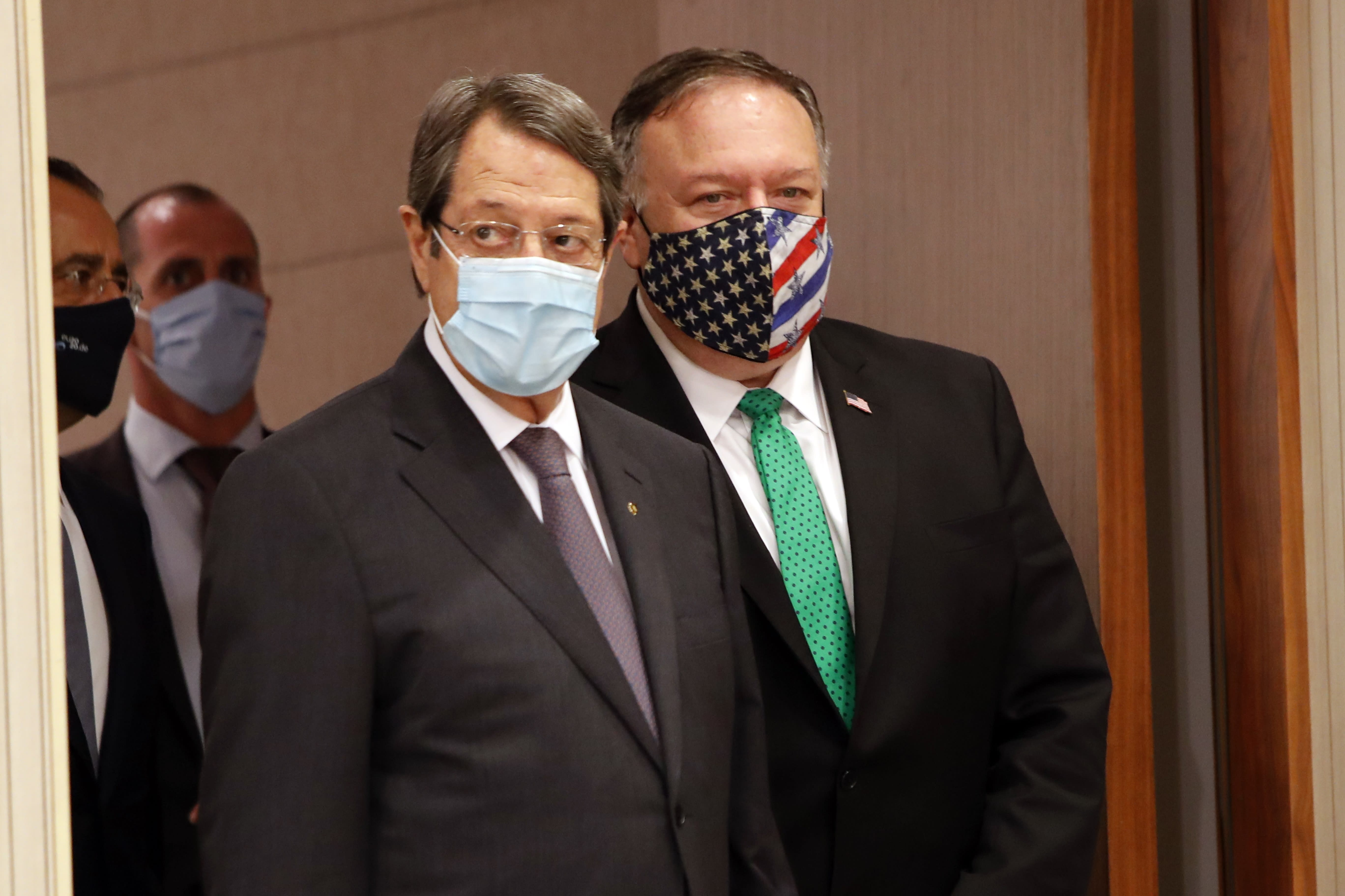 U.S. Secretary of State Mike Pompeo, right, Cypriot President Nicos Anastasiades arrive for a press conference at the Presidential Palace in Nicosia, Cyprus, Saturday, Sept. 12, 2020. Pompeo's lightning visit to Cyprus aimed to de-escalate a confrontation between Greece and Turkey over energy reserves in east Mediterranean waters and to affirm Washington's continued engagement in the tumultuous region four days after Russian Foreign Minister Sergey Lavrov pitched Moscow's offer to help ease tensions during his trip to the island nation. (AP Photo/Petros Karadjias, Pool)