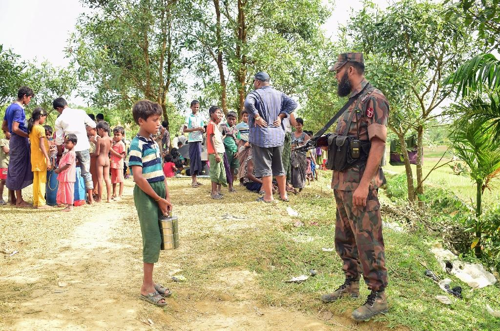 "Those unable to sneak in are stranded along the ""zero line"" border zone, where Bangladeshi officials have noticed a conspicuous absence of men among the civilians crowding the checkposts (AFP Photo/Emrul Kamal)"