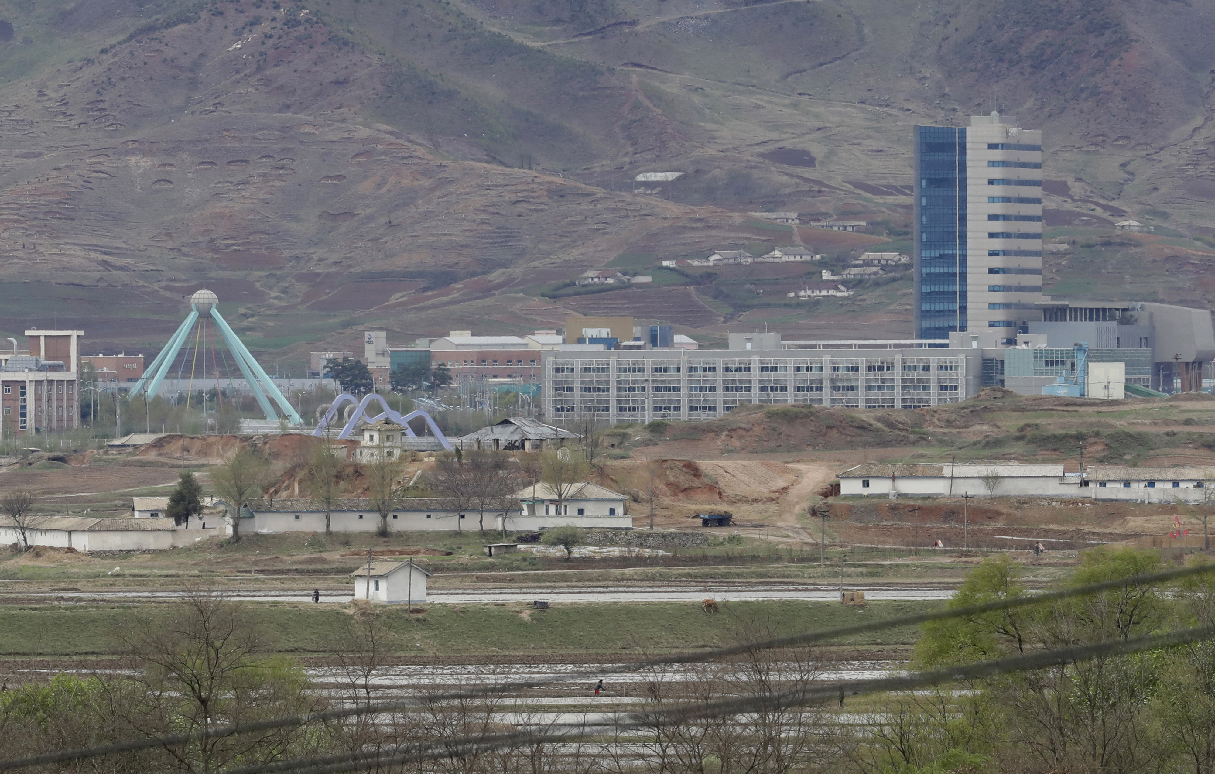 FILE - In this April 24, 2018, file photo, the Kaesong industrial complex in North Korea is seen from the Taesungdong freedom village inside the demilitarized zone during a press tour in Paju, South Korea. South Korea's Unification Ministry on Wednesday, Oct. 10, 2018, said the water is being supplied to a liaison office between the countries that opened in Kaesong in September 2018 and has been provided to the town's residents as well. (AP Photo/Lee Jin-man, File)