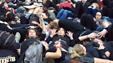 Chicago teens stage 'die-in' to demand action on climate change; one man arrested