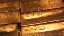 Gold soars to six-year high, stocks slide after Powell speech