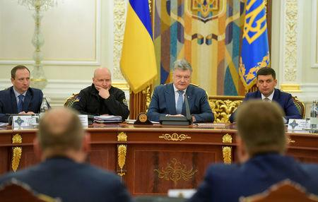ukrainian president poroshenko attends a meeting with members of the national security and defence council in