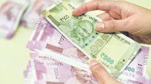 Rupee trades flat ahead of key inflation data