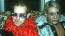 Elton John remembers surprising Iggy Pop onstage — in a gorilla costume