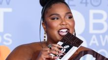 Lizzo paired her chocolate dress with chocolate scented nail polish at the Brits