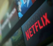 Netflix shares hit record high after blockbuster results