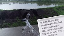 'Move to higher ground': Queenslanders receive ominous text as dam breaks