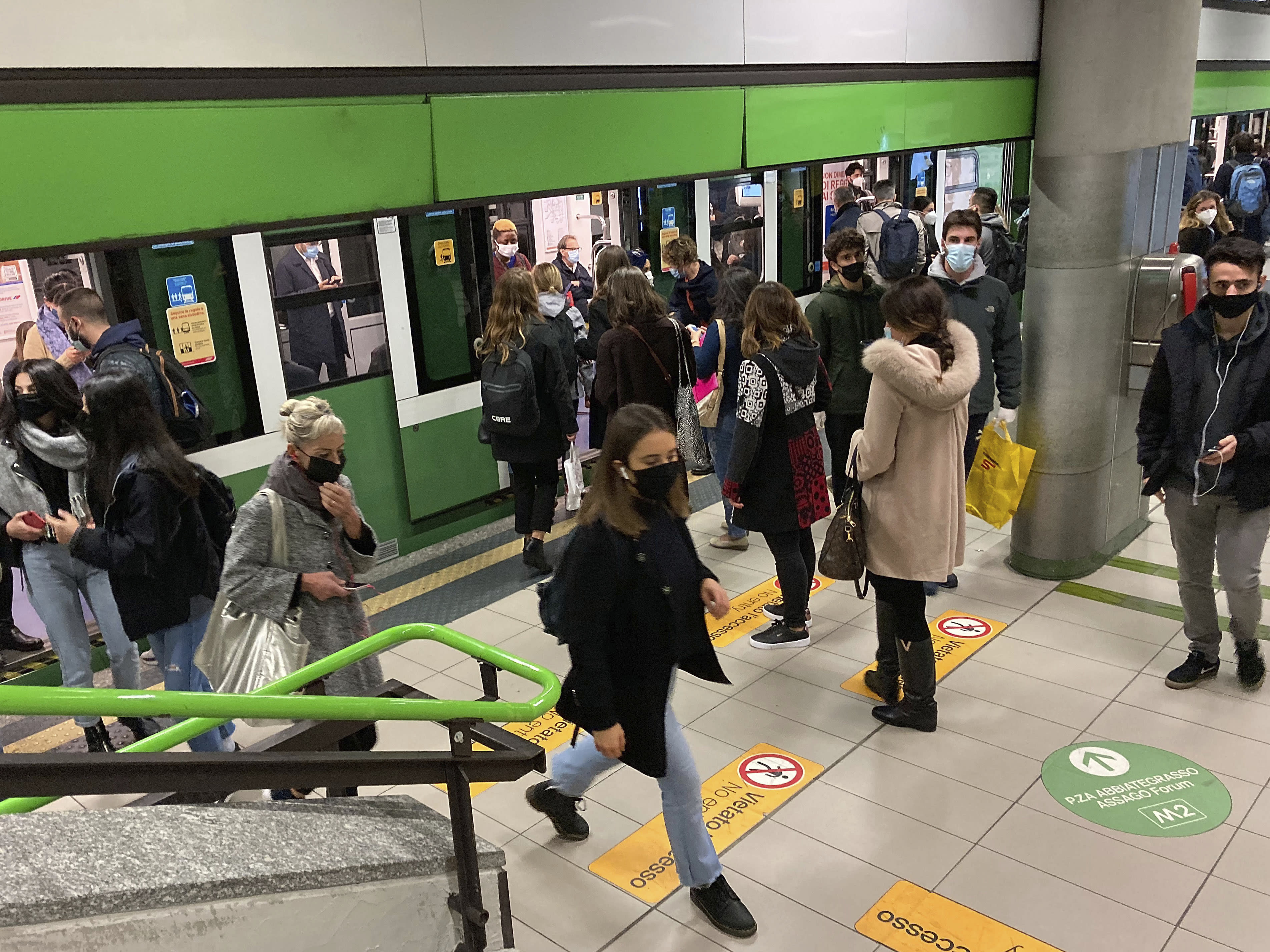 People wear face masks to prevent the spread of COVID-19 at a subway station, in Milan, Italy, Wednesday, Oct. 14, 2020. Italian Premier Giuseppe Conte says the aim of Italy's new anti-virus restrictions limiting nightlife and socializing is to head off another generalized lockdown. (AP Photo/Luca Bruno)