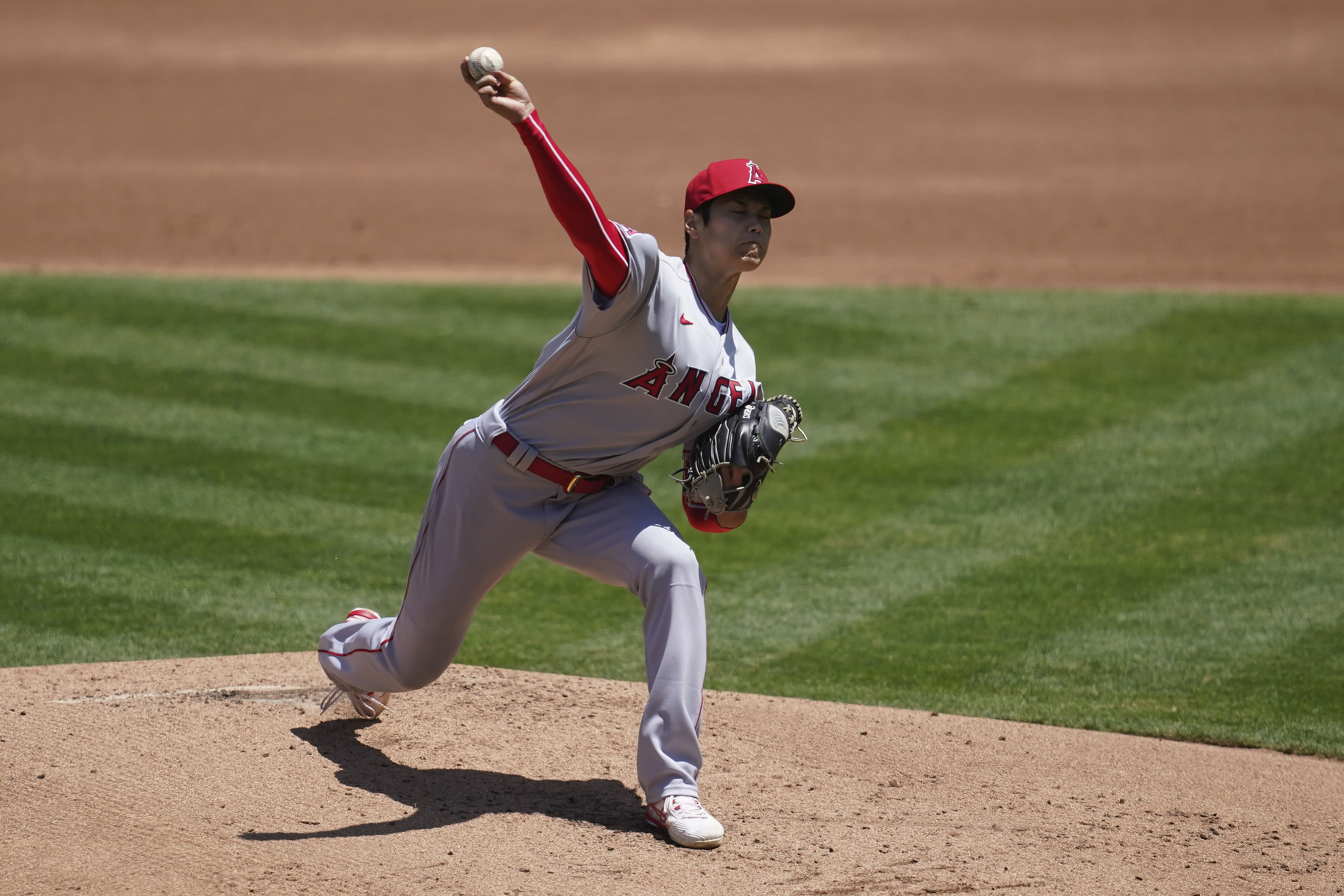 Los Angeles Angels' Shohei Ohtani throws against the Oakland Athletics during the first inning of a baseball game in Oakland, Calif., Sunday, July 26, 2020. (AP Photo/Jeff Chiu)