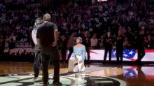Singer Justine Skye takes a knee while performing national anthem at Brooklyn Nets home opener
