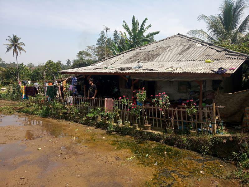 Ari Harifin stands at his family's house amid the coronavirus disease (COVID-19) outbreak in Sukabumi