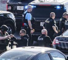 The Latest: Police standoff on Atlanta-area freeway ends