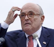 The Latest: Giuliani aims to clarify collusion comments
