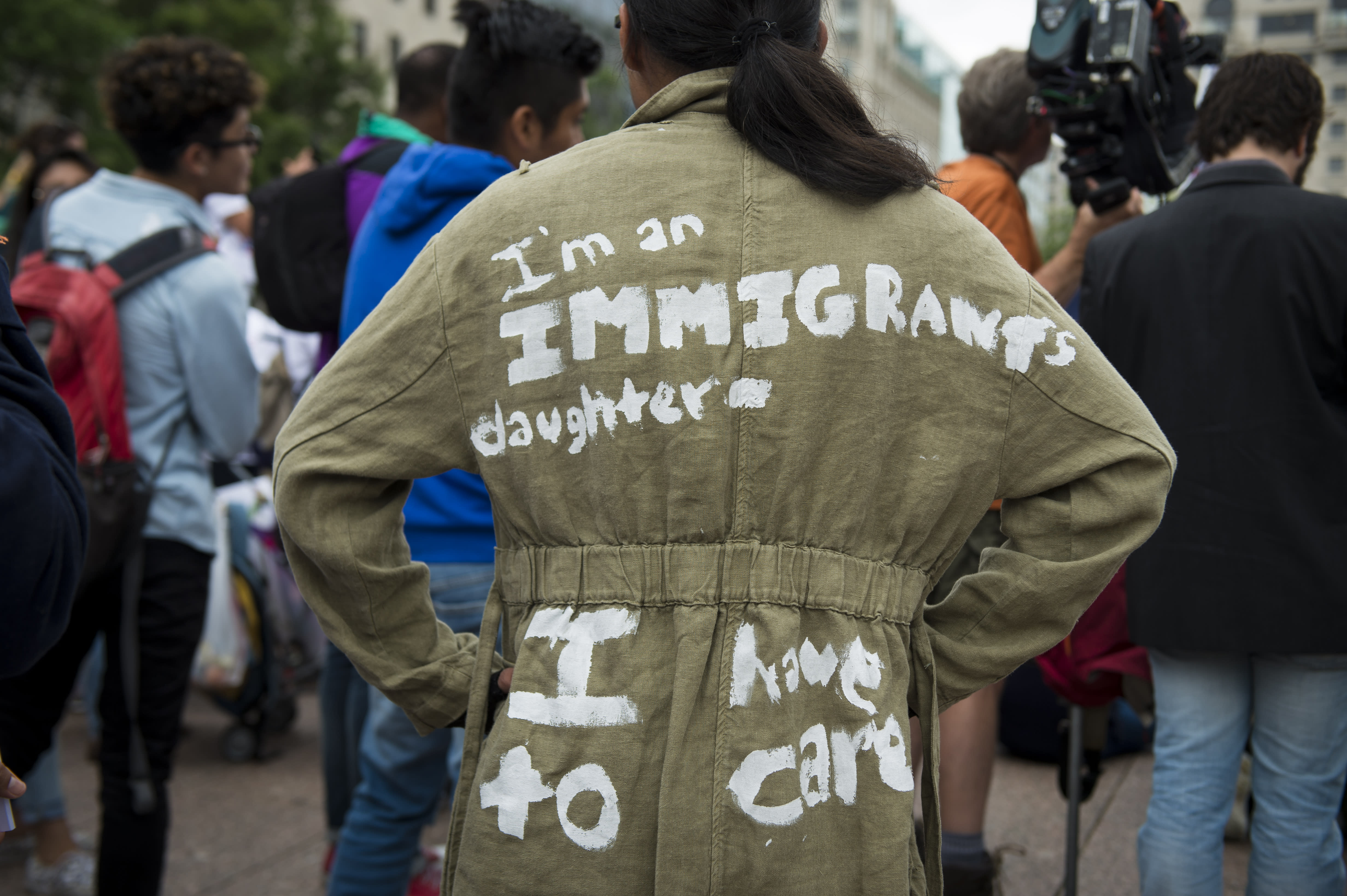 <p>A girl wears a jacket that references that of the First Lady Melania Trump during a CASA in Action rally at Freedom Plaza in downtown Washington, D.C. The protest was organized to protest the Trump Administration zero tolerance policy that separates children from their families at the southern border Wednesday June 27, 2018. (Photo: Sarah Silbiger/CQ Roll Call/Getty Images) </p>