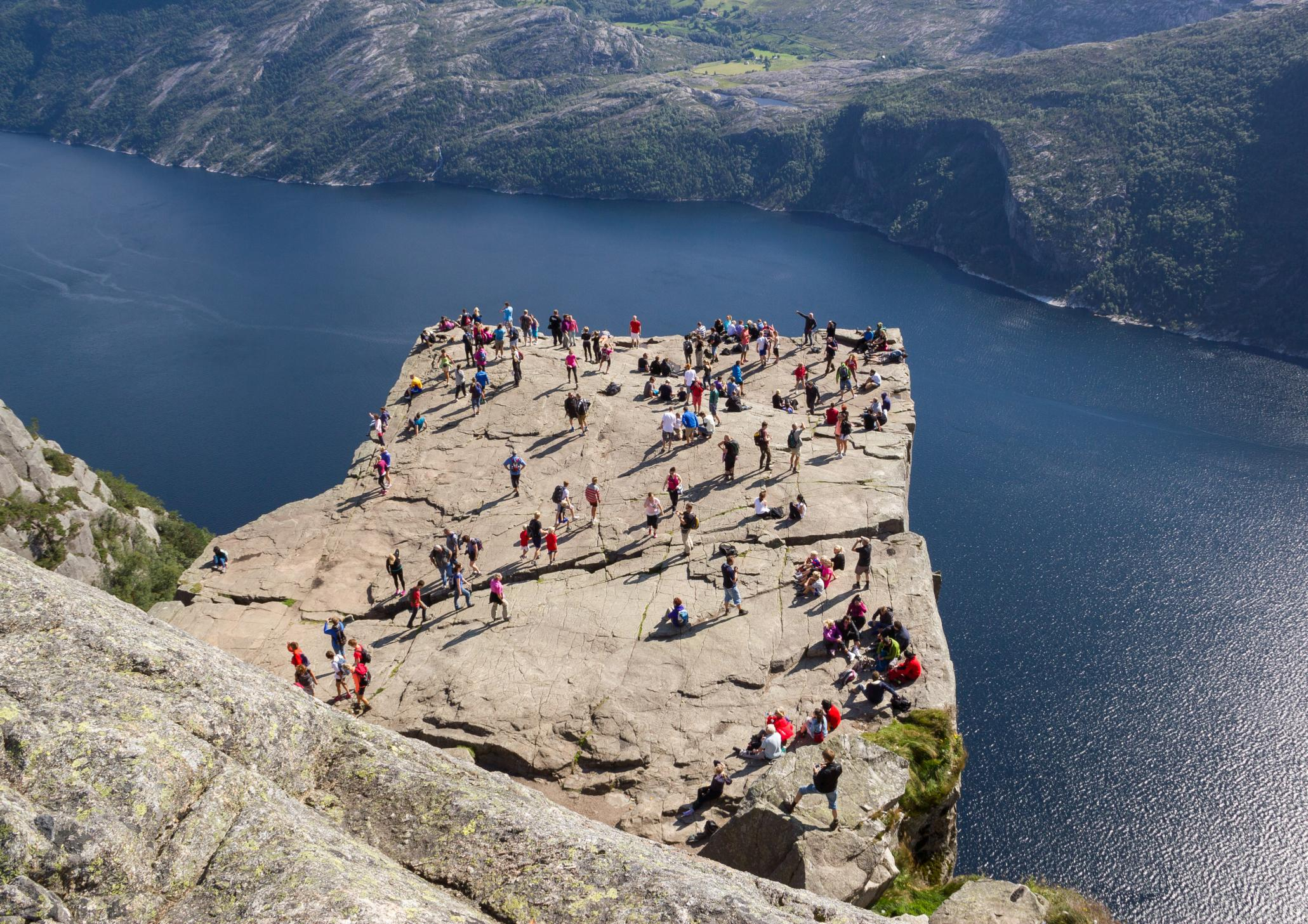 "<p>The 200,000 or so tourists who visit this dangerous-looking hangout spot in Norway each year don't seem perturbed by its 1,970ft drop into a fjord below but Preikestolen, also known as Pulpit Rock, is as dangerous as cliffs come. There is no safety railing on the edge of the cliff but there have been no tourist fatalities and authorities say they opted not to install a fence as it would harm the natural beauty and could even encourage dangerous behaviour. They say they ""cannot fence in all nature in this country"" and Norwegians, who are more accustomed to ""dangerous nature,"" support this.</p>"
