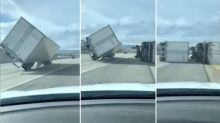 Frightening footage of trucks being overturned by 120km/h winds on highway