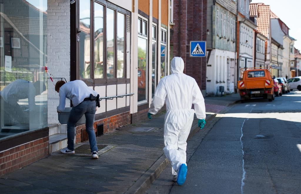 A forensic expert arrives to secure evidence at a cordoned off house in Wittingen, northern Germany, where two women were found dead in the apartment of one of the three people killed by crossbows at a Bavarian hotel (AFP Photo/Christophe Gateau)