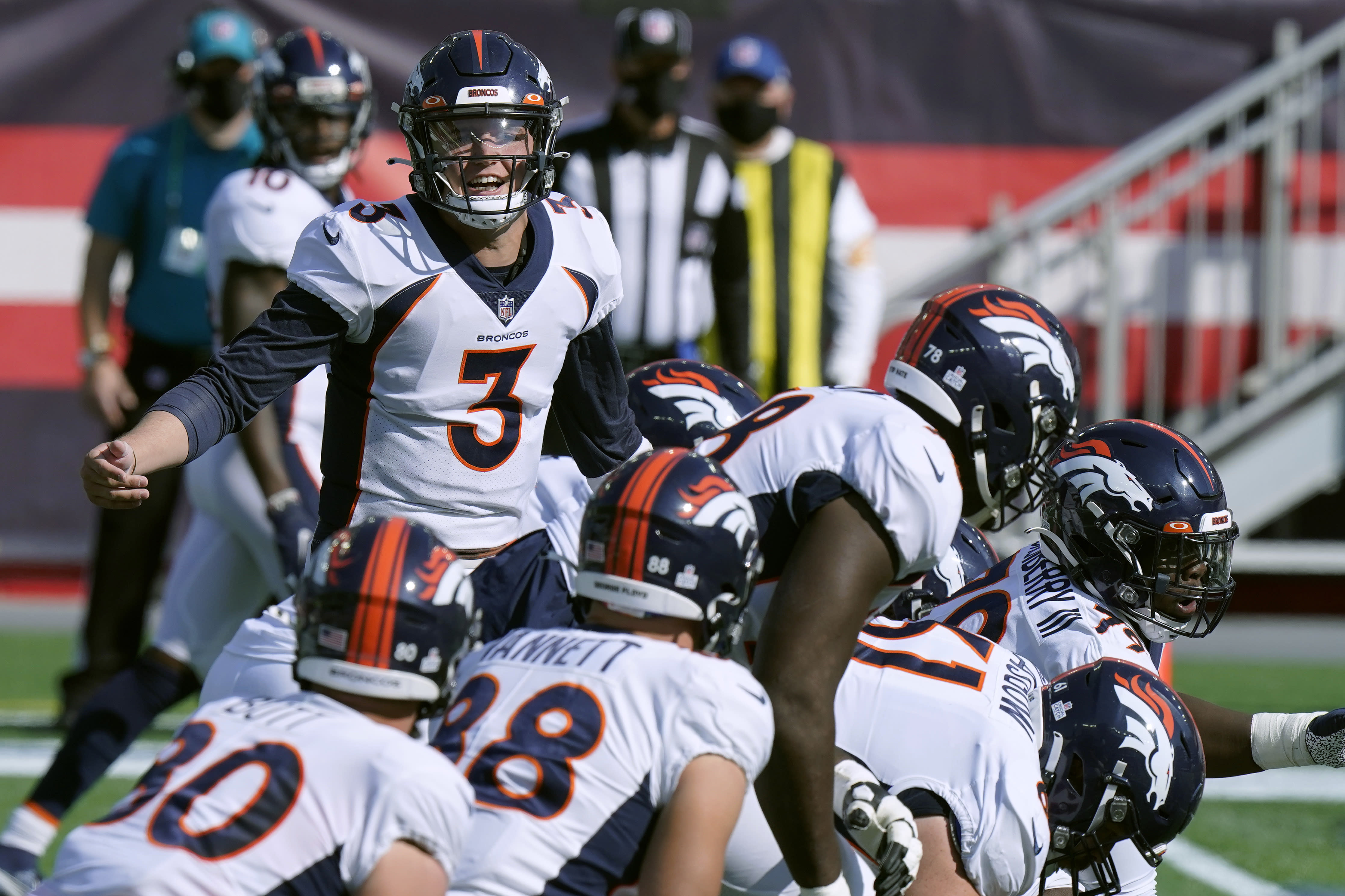 Denver Broncos quarterback Drew Lock (3) calls signals at the line of scrimmage in the first half of an NFL football game against the New England Patriots, Sunday, Oct. 18, 2020, in Foxborough, Mass. (AP Photo/Steven Senne)