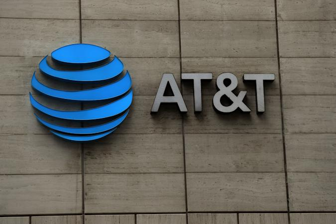 DALLAS, TEXAS - MARCH 13:  The logo of AT&T outside of AT&T corporate headquarters on March 13, 2020 in Dallas, Texas.  AT&T is allowing employees to work remotely from home if they have the ability to do so, as a safety measure due to COVID-19. (Photo by Ronald Martinez/Getty Images)