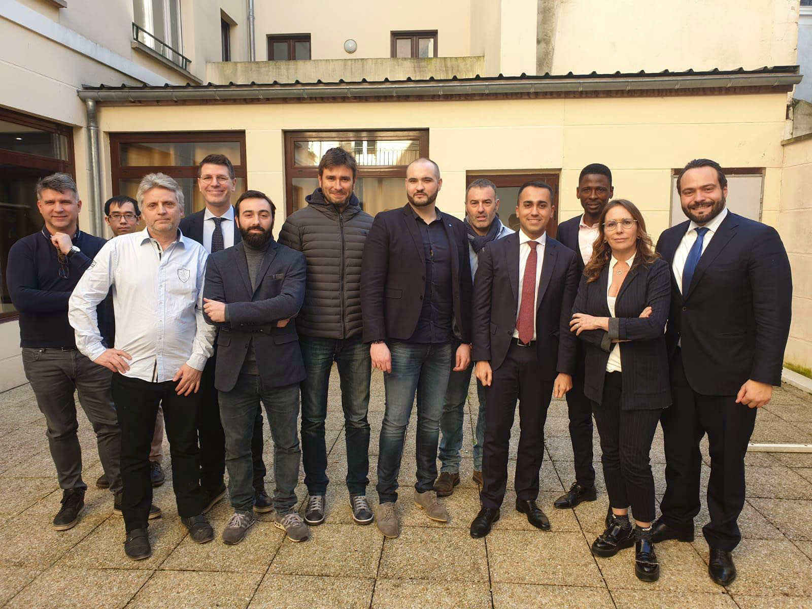 In this photo taken on Tuesday, Feb. 5, 2019 near Paris, Christophe Chalencon, 5th from right, one of the leading figures of the yellow vest movement, poses for a group photo with yellow vests' members and Italy's Five-Star Movements' leaders Luigi Di Maio, 4th from right, and Alessandro Di Battista, 6th from left. France kept up pressure on Italy Friday amid their biggest diplomatic spat since World War II, as business leaders from both countries appealed to their leaders to restore calm. The main trigger for the crisis appeared to be Di Maio's meeting in a Paris suburb this week with members of the yellow vest movement seeking seats in the European Parliament. (Five-Star Movement via AP)