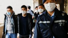 Special Report: Hong Kong activists retreat as China-style justice comes to their city