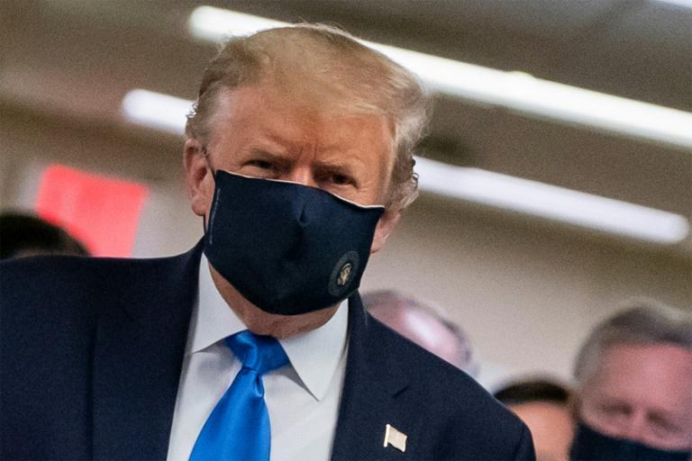 President Donald Trump makes a rare appearance in a mask as part of a new attempt to restore his standing with Americans over the handling of the coronavirus pandemic (AFP Photo/ALEX EDELMAN)