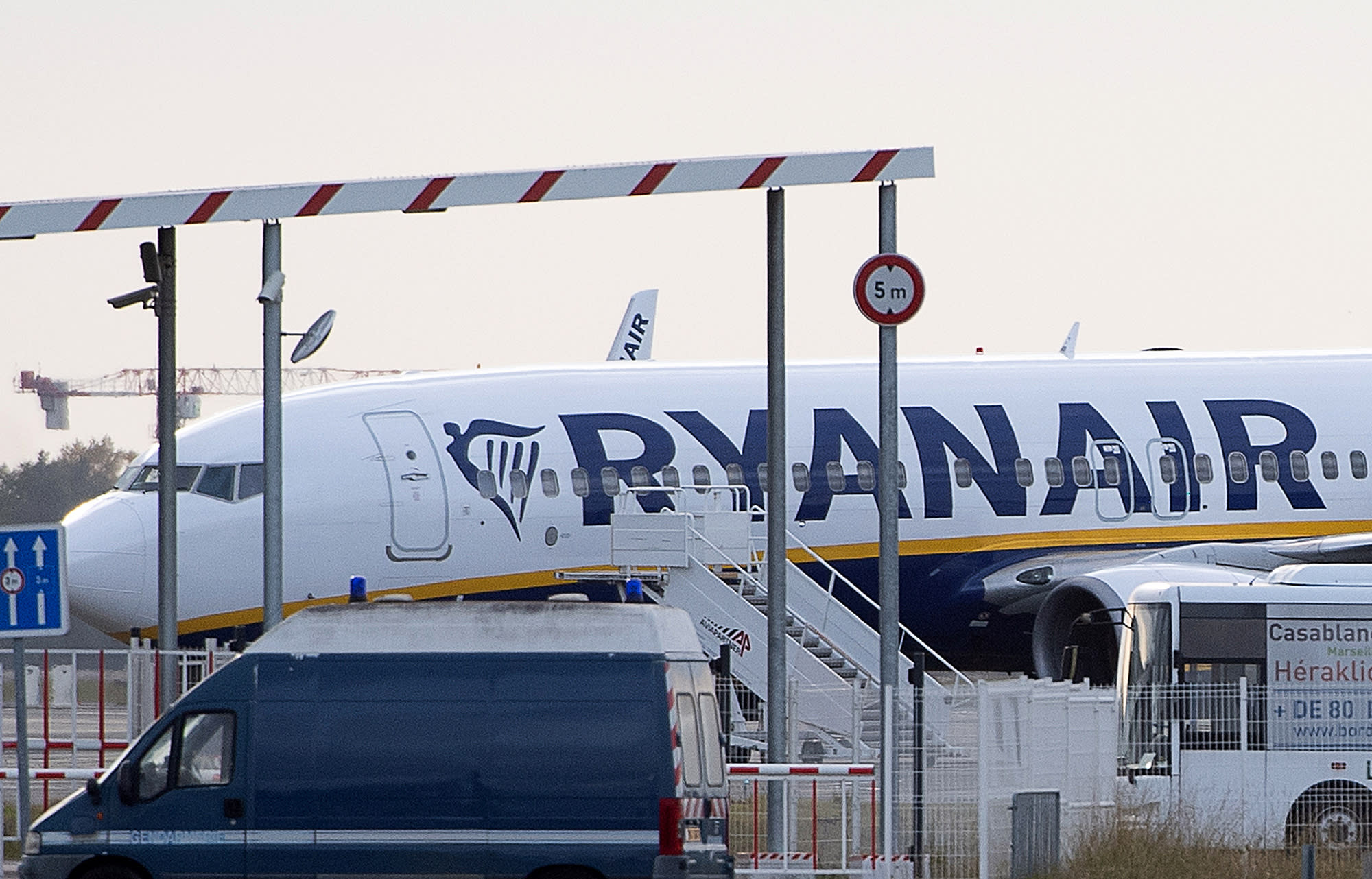 """A Ryanair plane sits on the tarmac at the Bordeaux-Merignac airport in southwestern France, after being impounded by French authorities, Friday, Nov. 9, 2018. Storms, strikes, computer failures _ you can now add """"your plane has been seized by the government"""" to the list of things that can delay your flight. (AP Photo)"""