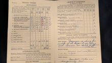 Edmonton man finds 60-year-old report card in wall of house