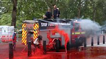 Extinction Rebellion activists lose control of hose while spraying 1,800 litres of fake blood onto Treasury building