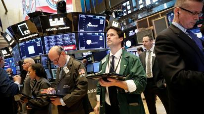 Wall St. opens flat as auto tariff threat weighs