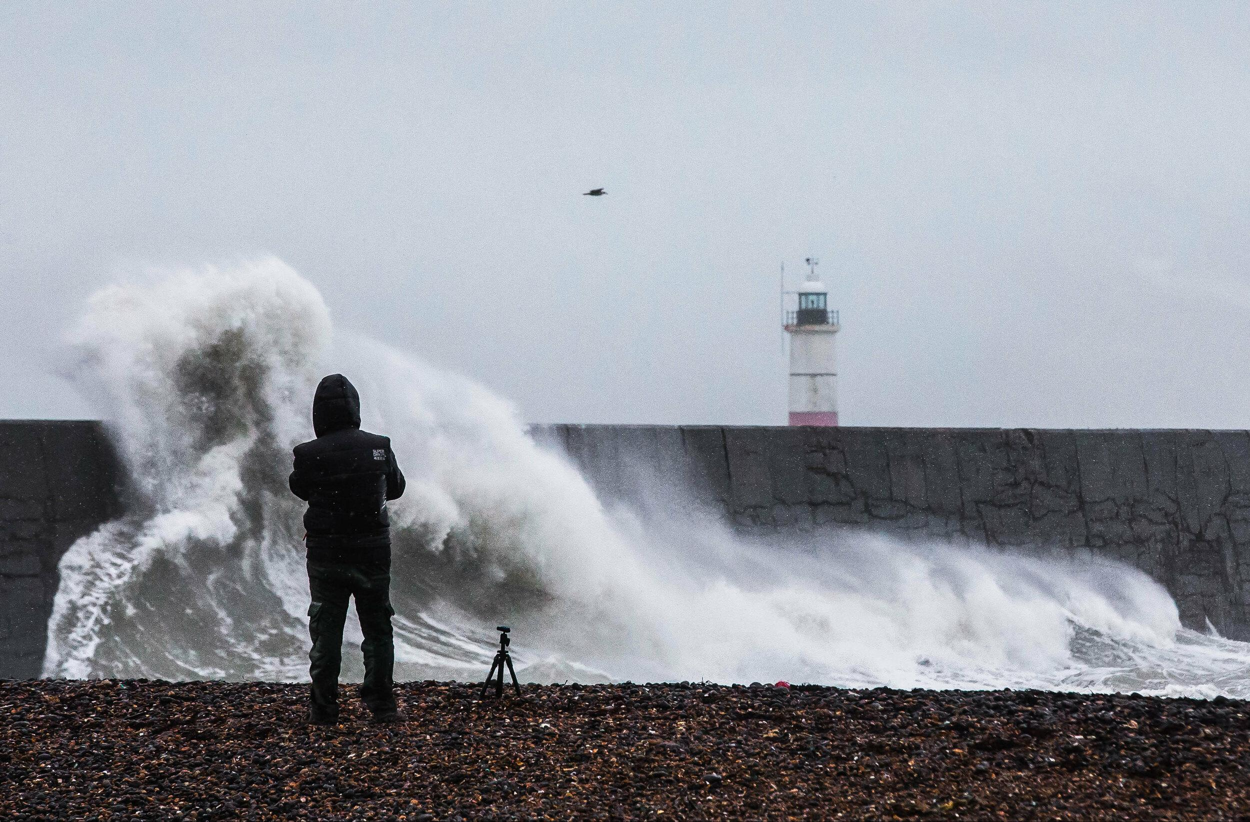 A photographer captures Storm Erik, as large waves and rough seas hit Newhaven, East Sussex