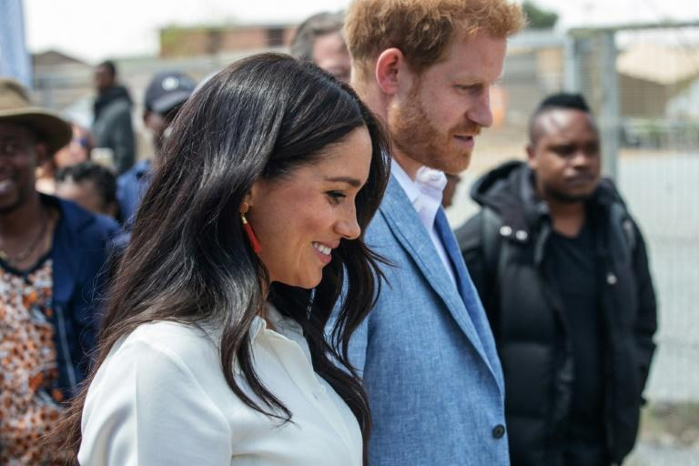 Britain's Prince Harry has said Meghan is being hounded by the press in the same way as his mother