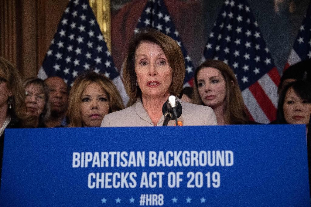 "US House Speaker Nancy Pelosi said that by introducing the legislation early in the new congressional session, Democrats are saying ""enough is enough"" on gun violence (AFP Photo/NICHOLAS KAMM)"