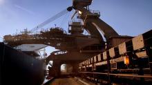 Twin Cyclones Batter Australia, Halting Mining Operations