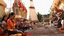 Laos crash victims moved to temple