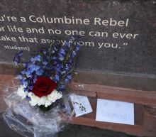 The Latest: People gather for Columbine memorial ceremony