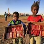 Refugees from Ethiopia conflict scratch a living in Sudan